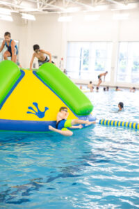 Fantastic Friday has Wibit water play in the big pool at Prairie Lakes Aquatic Center