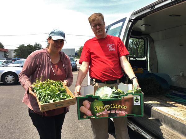 DPParks gardener Ellie with Pantry volunteer David.